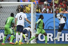France's Paul Pogba heads the ball to score a goal against Nigeria during their 2014 World Cup round of 16 game