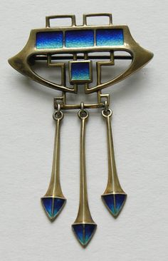 "Jugendstil Enameled Sterling Brooch.jpg  	Jugendstil Enamel Sterling Silver Brooch This striking Arts and Crafts period brooch is done in the Jugendstil style with lovely shaded blue enamel (dark blue to aqua).  The brooch measures 2 1/2 inches by 1 1/2 inches and has it's original ""C"" clasp.  The brooch has a gold wash and is marked sterling silver."