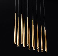 "RH Modern's Aquitaine Linear Chandelier 72"":Inspired by French minimalist lighting of the 1960s, Jonathan Browning's elegant design features solid brass forms suspended from slender black cords. Inset LED bulbs at the tips offer warm, glowing light."