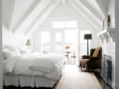 the white on white bedroom - complete with a view over the bay - calming and beautiful...