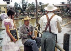 "Walt with ""Becky Thatcher"" and ""Tom Sawyer"" fishing on the Rivers of America."