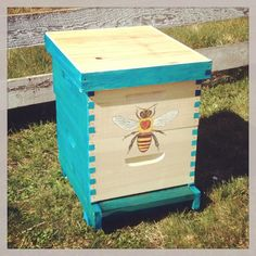 Bee hive! For honey & to pollinate the garden. I like how they are cheerfully painted. Each hive a different color so the bees can find their way home