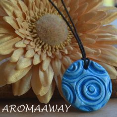 Blue Swirl Handmade Essential Oil Diffuser Pendant by AromaAway on Etsy https://www.etsy.com/listing/396875256/blue-swirl-handmade-essential-oil