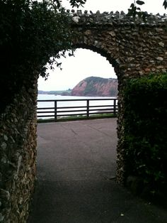 Looking through the archway from the Connaught Gardens, Sidmouth, Devon, towards Jacob's Ladder and the sea