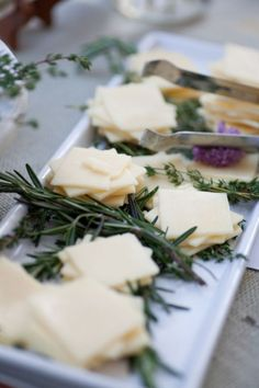 cheese-platter with fresh herbs. Four different cheeses served with local lavender honey and homemade jams and chutneys. Rustic Farm Wedding
