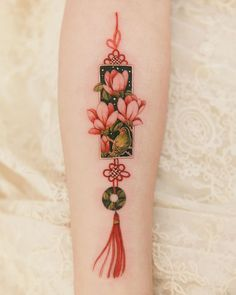 Red norigae with magnolia and small bird inside. Norigae represents precious relationship between individuals. Done in April Red norigae with magnolia and small bird inside. Norigae represents precious relationship between individuals. Done in April Korean Tattoos, Asian Tattoos, Tribal Tattoos, Triangle Tattoos, Piercing Tattoo, Arm Tattoo, Piercings, Wrist Tattoos, Tatoos