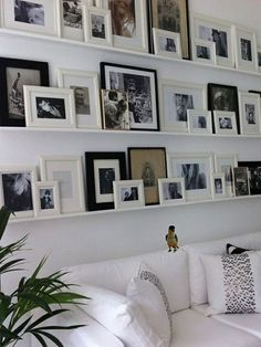 gallery wall using ledges and frames in black and white - great flexibility to swap out photos