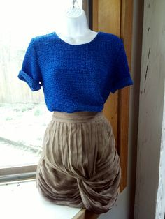 royal blue textured blouse will go nicely with taupes and browns.