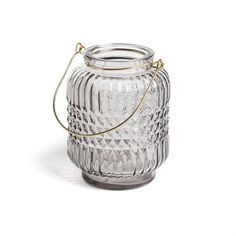 Light Grey Embossed Glass Candle Lantern.  This stunning little glass embossed candle lantern features a gold metal handle and is perfect for tealights and small candles. Watch as the light shines through the embossed glass and creates a gorgeous pattern of light around the room. Pair with some of the other coloured lanterns from the same range for the perfect set.