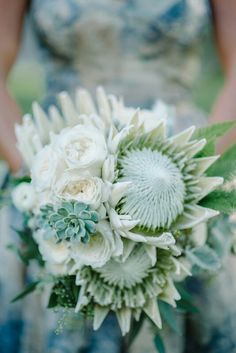 Unique Bridal Flowers Of: White/Green King Protea, Green Succulent, White English Garden Roses, White Ranunculus, Green Sword Fern, Green Seeded Eucalyptus, Dusty Miller.........