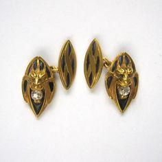 Diamond, enamel and gold cufflinks.