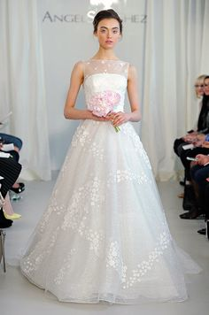 The sheer overlay of this Angel Sanchez gown is sweet and sophisticated with a playful texture.