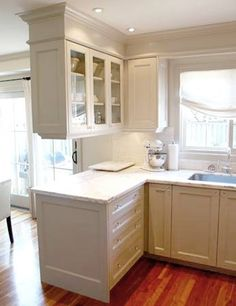 Cabinets and Walls: hand painted Benjamin Moore Revere Pewter      Knobs: Crystal      Countertop: Crema Classico