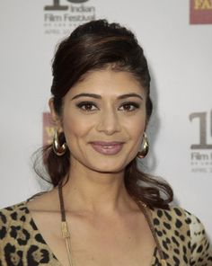 Actress Pooja Batra arrives at the Indian Film Festival of Los Angeles Opening Night Gala in Hollywood, California April 10, 2012.