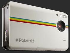 Polaroid instant camera with internal printer.