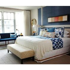 Navy blue contemporary bedroom design roon with transitional details