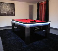 The Lambert pool table is not only a pool table, but it's also a dining table and given its striking stainless steal body and LED under-lighting it's more a work of art!
