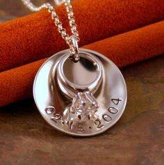 $40.00 anniversary necklace. I can put all my temporary engagement rings on the necklace! :)