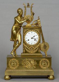 Relogio Frances Imperio em bronze gilded a ouro do sec.18th, assinado, 55cm de altura,