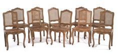 A set of ten Louis XV carved beechwood and caned chairs circa 1745, eight stamped,  Pere Gourdin. Sotheby's