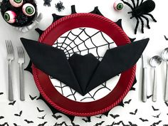 Get creative with your Halloween place settings! These fun bat napkins are a cinch, and take less than one minute to fold. No need to be an origami expert to master...