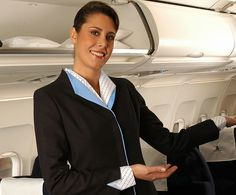 Flight attendant with the last uniform used by Mexicana crew.
