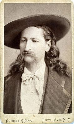 """August 2, 1876. Frontiersman """"Wild"""" Bill Hickok is shot from behind and killed while playing poker at a saloon in Deadwood, South Dakota. At the time the cards he was holding were a pair of black aces and a pair of black eights -- since known as the dead man's hand"""