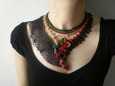 This is a crochet necklace made from quality cotton fibers and delica beads, with freeform crochet techniques.    The body of the necklace