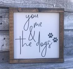 You Me & The Dogs | Dog Lover | You Me And The Dogs Sign | Farmhouse Sign | Rustic Sign | Animal Lover Sign | Fixer Upper •Framed wood word sign •White background, black lettering and espresso frame •Measures 8.5 in wide x 8.5 in tall •Freestanding or hangable by frame