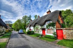 What makes a cottage so distinctive from other small homes is its dark thatched roof, and the way it envelops the cottage like melted cheese.(funny how cottage cheese looks nothing like this) These. Cute Cottage, Old Cottage, Cottage Homes, Cottage Style, Brick Cottage, Cottages England, Thatched House, Thatched Roof, Cottage Design