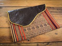 NZFINCH ipad sleeve, brown leather and coffee coloured vintage batik fabric with pompom detail