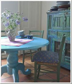 Blue table & primitive blue cabinet...lovely.