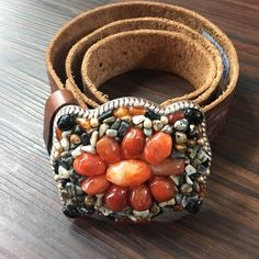 Genuine Leather Belt with Silver Stone Buckle This genuine embossed leather belt features a stunning stone buckle. Buckle is removable. Pair with jeans or loosely around a top. Just Reality Accessories Belts