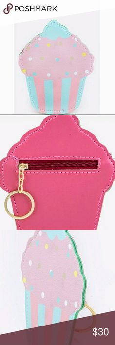 """🎂NEW ITEM🍦Uber Cute Cupcake Coin Purse!🍦🎂💋 Make a statement with this Uber Cute Cupcake Coin Purse w/an attached key chain ring!!🍦🎂Sweetness in a purse?! Why YES!!🙌🙌Pictures don't do it justice for sure!!😘💣💥💥💥Vegan leather, zip closure, lead & nickel compliant. Length 4.75"""" Width .2"""" Height 6"""" Bags Mini Bags"""