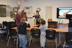 Stretching in the middle of the presentation at the Idyllwild Library 2/4/2017 to illustrate  how to be a healthy writer.