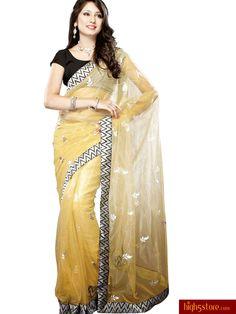 http://www.high5store.com/designer-sarees/308001-charming-cream-net-saree.html