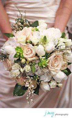 pretty bridal bouquet with blush and ivory flowers