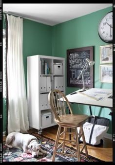 Green office with green paint color, Ikea RITVA Panels with black ribbon trim, architect's desk, oak stool, clock and white Ikea Expedit Bookcase. Home Office Design, Home Interior Design, Interior Ideas, Ikea Expedit Bookcase, Ikea Micke, Office Paint Colors, Paint Colours, White Desks, My Living Room