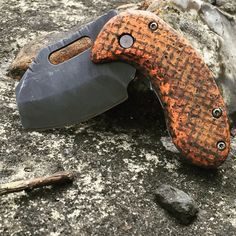 Mad Max inspired Boker Nano, this one I went all out warfare on the stock blade; making a nice snub nose. Distressed the blade and a dark acid wash, custom orange burlap micarta scales and bronzed hardware.