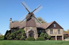 Windmill House - Wheaton, Illinois: - Built in 1942 from materials salvaged from a nearby farm, the Windmill House has an old-fashioned windmill above its front door, and is surrounded by otherwise normal suburban homes.