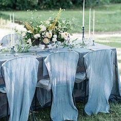 Airy fabric, dyed to match the blue in the wedding palette, draped this couple's dining table and chairs, creating a breezy, elegant reception look. ✨ #marthaweddings 📷: @kateholsteinphoto | 📋: @pearlandgodiva | 🌸: @saipua