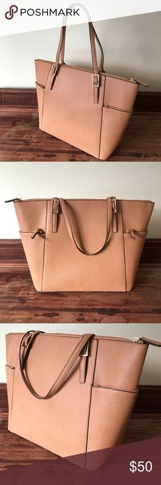 "Cain JustFab Purse / Tote Bag in Soft Tan Brand new, never used! JustFab Website ""This structured tote is perfect for all of your daily needs. With its structured design for instant polish and large zip top compartment for function, you'll have the best of both worlds."" Material: Faux Leather Size: 17.5L x 11.5H x 5D Hardware color: Gold Shoulder drop measurement : 9"" Pockets: 2 exterior Zip, 1 interior pocket, 1 interior zip Closure: Zip closure JustFab Bags Totes"