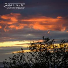 www.jamesatruett.com - The gentle pink rays of the rising early Autumn sun reflect on clouds over #Ireland's Fergus River Valley near Ennis in County Clare.