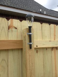 Take a solar stake light & add Pipe Strap/Clamp & screw the strap/clamp into the fence. What a great idea. Need to paint the fence and would be great by back gate