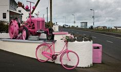 A tractor and bicycle at Ballintoy, painted pink to celebrate the Giro d