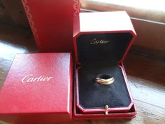 Currently at the #Catawiki auctions: Cartier Trinity classic, white, pink and yellow gold, 12gr., No. 63mm Europe,...