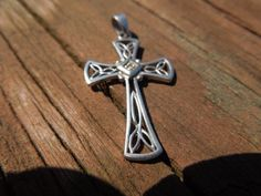 Vintage Silver Cross Pendant. Celtic Style with a Single Clear Stone. Stamped 925 RJ  Ask a Question $25.00 USD