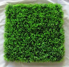 Gorgeous Thick Artifical Grass Mat  The possibilities are endless with how you can use this item.  Artifical grass mats make great kids birthday party decorations.  Use on your lolly buffet or food table.  It would also make a fun centrepiece decoration for an outdoor wedding theme.  Fun, colourful, cute, functional and multi-purposed - let your mind wander with the possibilites.  The mat measures 25cm x 25cm.