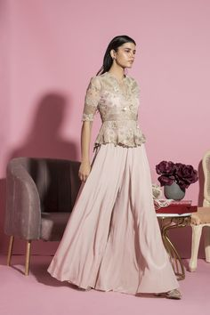 SANYA GULATI Featuring a nude pink peplum top in viscose crepe and net base with dori embroidery. It is paired with matching kalidar palazzo pants. Indian Gowns Dresses, Indian Fashion Dresses, Pakistani Dresses, Indian Wedding Outfits, Bridal Outfits, Indian Outfits, Indian Fashion Designers, Indian Designer Outfits, Peplum Top Outfits