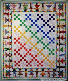 I love the little people around the border and the rainbow of colors. Just a very happy quilt.